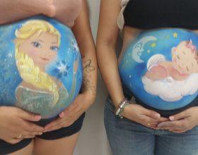 Exhibición pintando barrigas embarazadas semana cultural