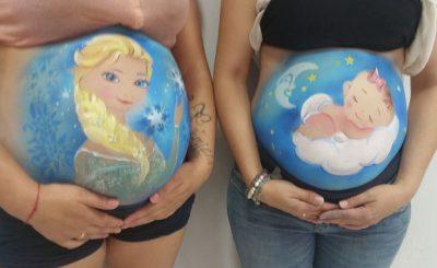 Exhibición pintando barrigas embarazadas